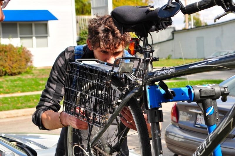 Dan from Neutral Cycle repairs a bike at CU Flea.