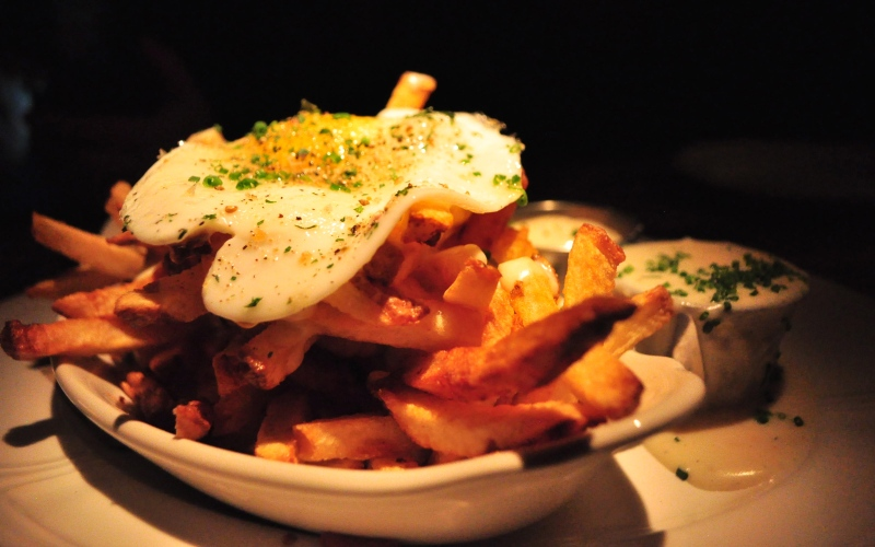 Fries with Crispy Egg and Mornay Sauce.