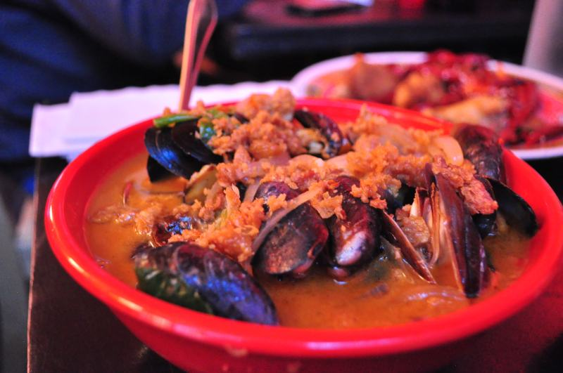 Mussels in a Spicy Tom Yum Broth with Fried Shallots and Brussels Sprouts.