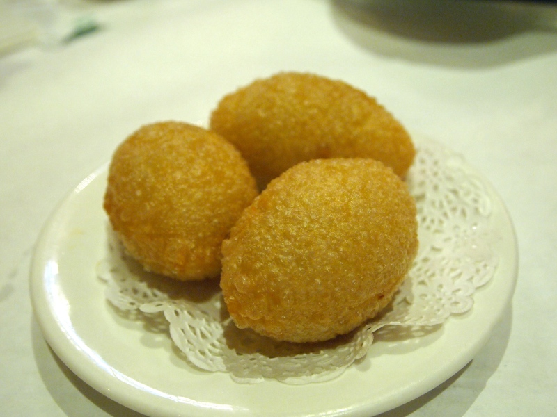 """""""Dinosaur Eggs"""" (Fried dough with meat filling."""