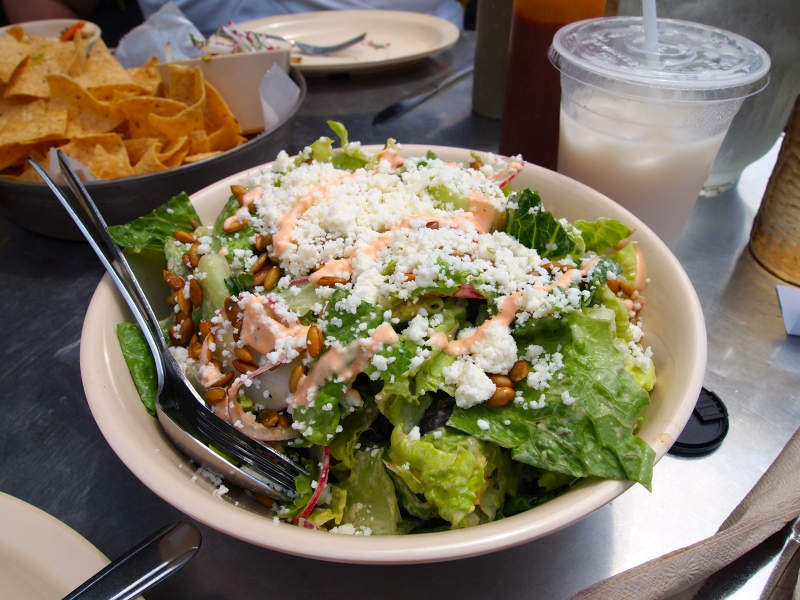 Salad with queso fresco and pepitas.